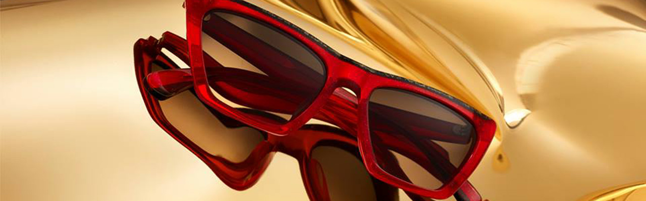 red sunglasses on a gold colored background