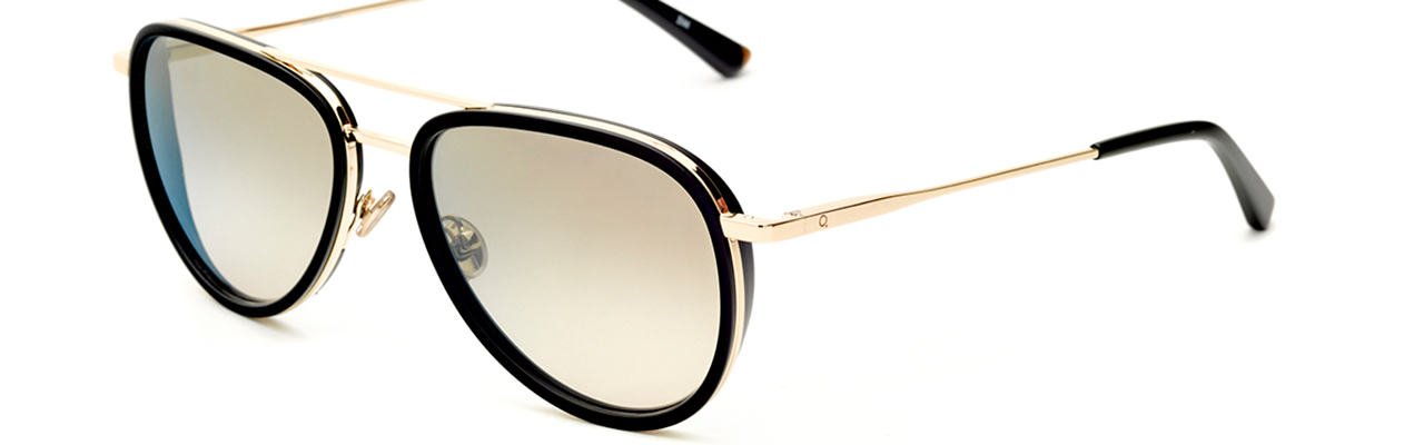 nice pair of glasses with gold frames and tinted lenses