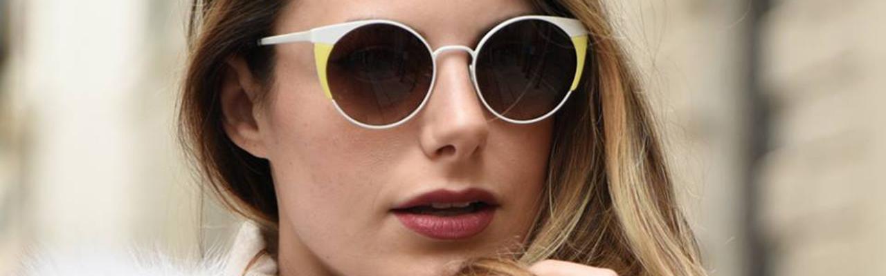 a woman wearing round sunglasses